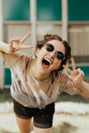 jolly woman using peace hand gesture