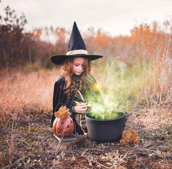 a kid playing a witch